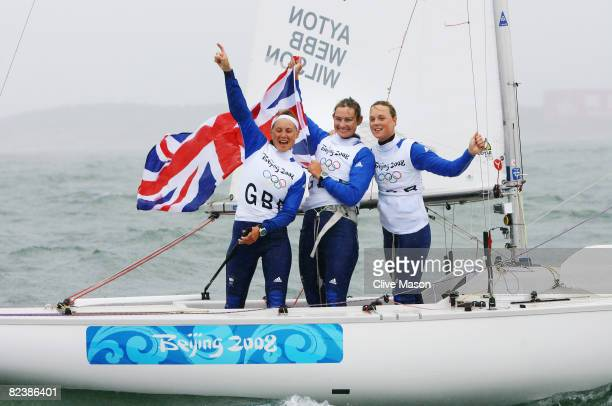 Sarah Ayton Sarah Webb and Pippa Wilson of Great Britain celebrate overall victory following the Yngling class medal race held at the Qingdao Olympic...
