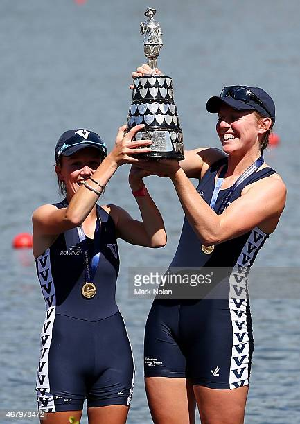 Sarah Banting and Charlotte Sutherland hold the trophy in the Womens Eight medal ceremony during the Sydney International Rowing Regatta on March 29...