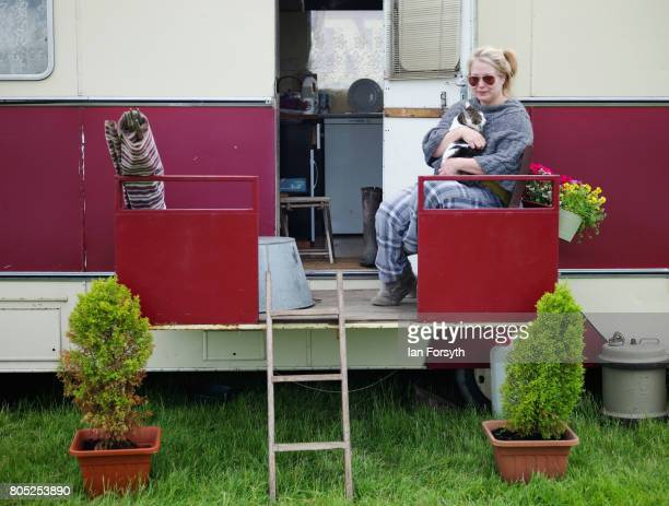 Sarah BarrattAtkin and her cat Doris sit on the deck of her caravan during the Duncombe Park Steam Rally on July 1 2017 in Helmsley United Kingdom...