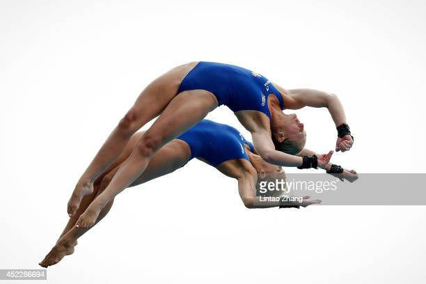 Sarah Barrow and Tonia Couch of Great Britain compete in the Women's 10M Synchro Springboard Final during day three of the 19th FINA Diving World Cup...