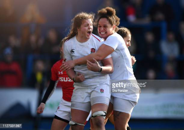 Sarah Beckett of England celebrates after touching down for a try with temmate Shaunagh Brown during the Wales Women and England Women match in the...