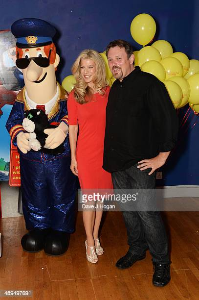 Sarah Beeny and Mike Disa attends the UK premiere of 'Postman Pat' at the Odeon West End on May 11 2014 in London England