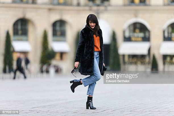 Sarah Benziane fashion and life style blogger @lescolonnesdesarah is wearing a New Look faux fur black coat a New Look orange pull over New Look blue...