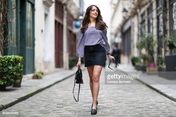 Sarah Benziane fashion and life style blogger wears a Newlook checked off shoulder top a Newlook black skirt Newlook black shoes and an Aliexpress...