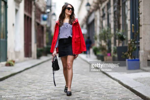 Sarah Benziane fashion and life style blogger wears a Newlook red parka coat a Newlook checked off shoulder top a Newlook black skirt Newlook black...