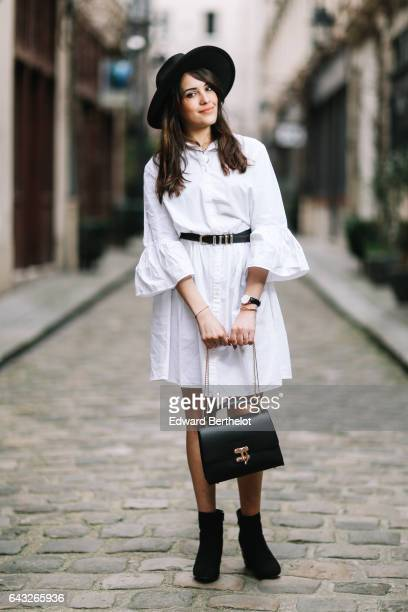 Sarah Benziane fashion and life style blogger wears a Newlook white dress a The Kooples belt a black hat Newlook black shoes a Christian Laurier bag...