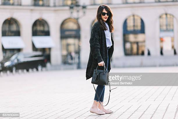 Sarah Benziane fashion blogger from Les Colonnes de Sarah is wearing a NewLook fur coat a NewLook striped blue and white shirt NewLook blue denim...