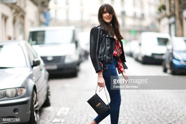 Sarah Benziane fashion blogger from Les Colonnes de Sarah wears a Zara black leather jacket a Zara red top with floral print Newlook blue denim jeans...
