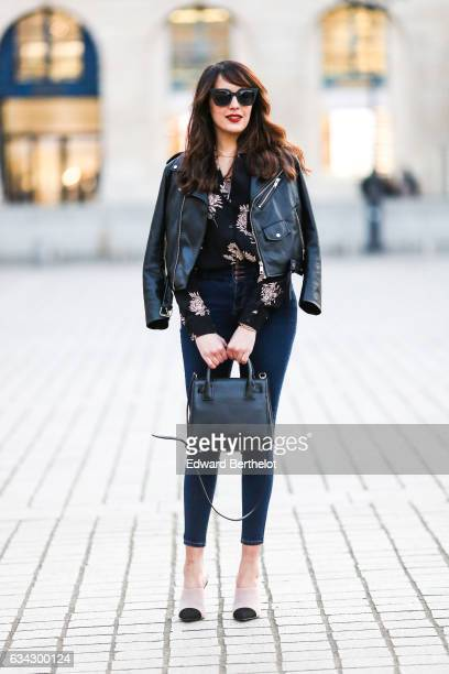 Sarah Benziane, fashion blogger from Les Colonnes de Sarah, wears Newlook white shoes with black heels, Newlook blue denim jeans, a Newlook black...