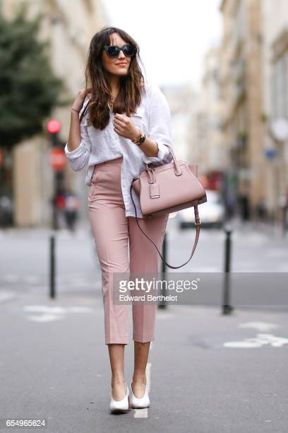 Sarah Benziane fashion blogger Les Colonnes de Sarah wears a New Look white shirt New Look pink pants Zara white shoes with wooden heels sunglasses...