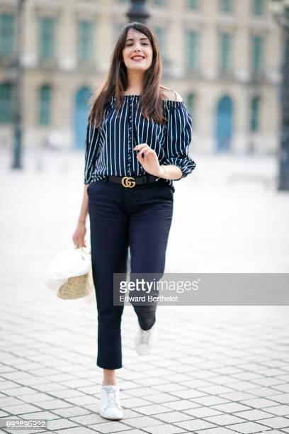 Sarah Benziane fashion blogger Les Colonnes de Sarah wears a New Look striped top Chloe Stora pants Le Coq Sportif white sneakers shoes a Zara white...