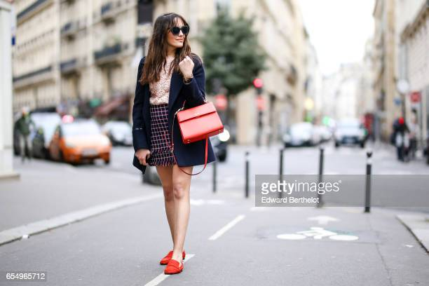 Sarah Benziane fashion blogger Les Colonnes de Sarah wears a Pimkie coat a Zara pink lace embroidered top a Zara checked skirt Zara orange shoes and...