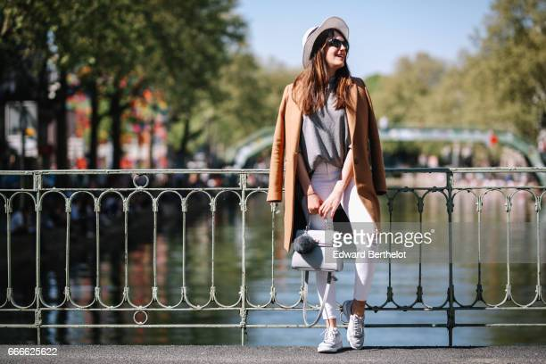 Sarah Benziane fashion blogger Les Colonnes de Sarah wears a Zara gray top a Zara brown coat New Look white ripped jeans Lacoste sneakers shoes a hat...