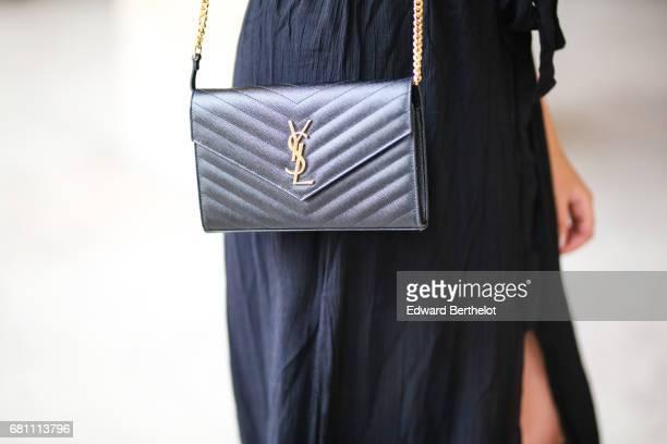 Sarah Benziane fashion blogger Les Colonnes de Sarah wears an IRL black dress Zara shoes and a YSL Saint Laurent bag on May 6 2017 in Paris France