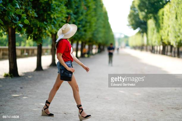 Sarah Benziane fashion blogger wears a Naive New Beater red tshirt with the printed inscription A La Folie and a printed heart a Pimkie blue denim...