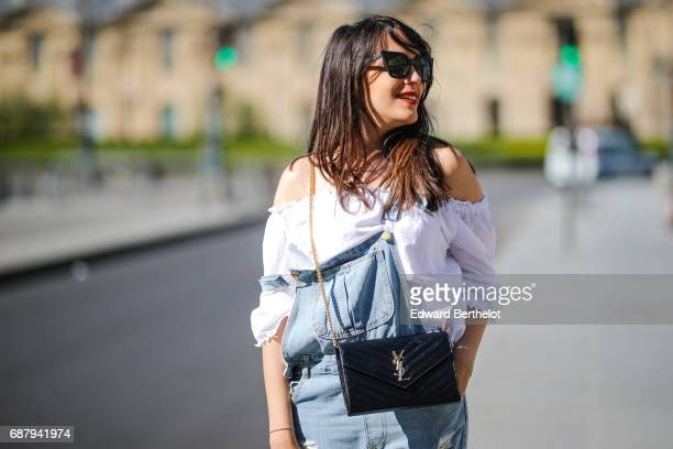 Sarah Benziane fashion blogger wears a New Look top a Romwe jumpsuit HM pink heels shoes and a Saint Laurent YSL bag on May 21 2017 in Paris France