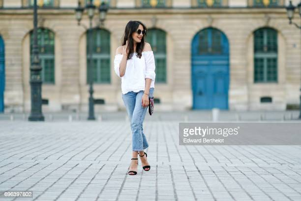 Sarah Benziane fashion blogger wears a New Look white lace off shoulder top New Look blue denim jeans Zara shoes and a New Look with embroidered...