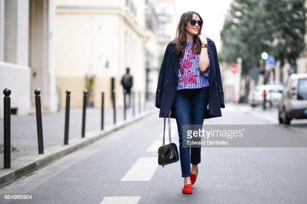 Sarah Benziane fashion blogger wears a Pimkie coat a Zara floral print top Bonobo jeans Zara shoes and a black leather bag on March 18 2017 in Paris...
