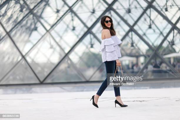 Sarah Benziane fashion blogger wears an Aliexpress off shoulder striped top Bonobo jeans Charles Keith shoes and a Saint Laurent YSL bag at the...
