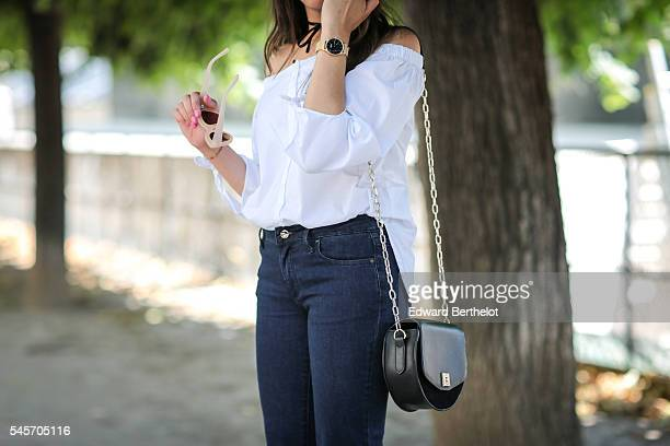 Sarah Benziane is wearing a Just Fab white top Just Fab jeans pants Newlook shoes and a Zara black bag in the Tuileries garden during a street style...
