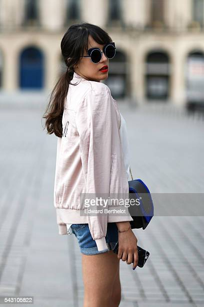 Sarah Benziane is wearing a New look jacket a Bershka short Charles Keith shoes a Minelli bag and L'Usine a Lunettes by Polette sunglasses after the...