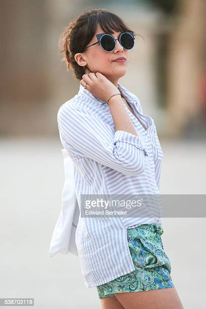 Sarah Benziane is wearing a New Look striped shirt a Zara green short and L'usine a Lunettes sunglasses during a street style session on June 07 2016...