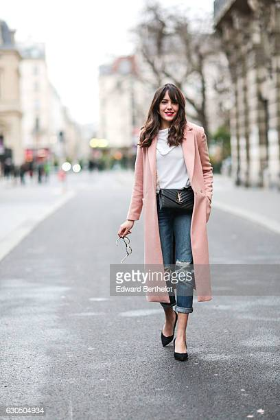 Sarah Benziane is wearing a New Look white top Zara blue denim ripped jeans Minelli black heels shoes a New Look pink long coat a Saint Laurent YSL...