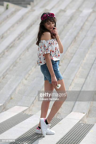 Sarah Benziane is wearing a white Bershka top with flowers a blue Stradivarius short and Stan Smith white shoes on June 20 2016 in Paris