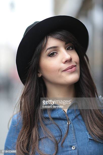 Sarah Benziane is wearing a Zara blue dress and a vintage black hat during a street style session in the 1st quarter of Paris on March 31 2016 in...