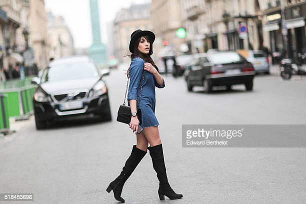 Sarah Benziane is wearing a Zara blue dress HM black boots a vintage black hat and a Mango black bag during a street style session in the 1st quarter...