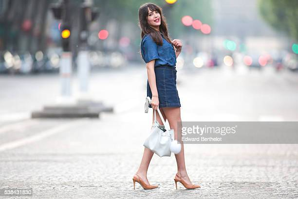Sarah Benziane is wearing a Zara blue shirt a New Look blue skirt Texto nude shoes a Lancaster white bag and a Michael Kors pompom during a street...