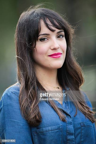 Sarah Benziane is wearing a Zara blue shirt and is posing for a portrait shot during a street style session on June 06 2016 in Paris