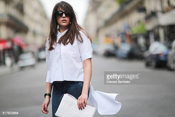 Sarah Benziane is wearing a Zara white top Pimkie blue jeans Zara yellow shoes and a Primark white clutch in the 9th quarter of Paris on March 28...