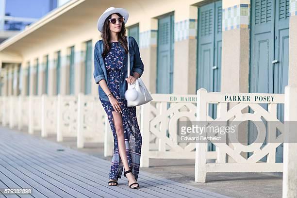 Sarah Benziane is wearing an HM blue dress L'usine a lunettes by Polette sunglasses HM shoes a Lancaster white bag a blue denim HM shirt and a...