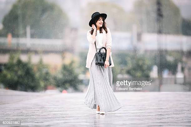 Sarah Benziane wears a Zara white top a New Look pink jacket a She Inside silver gray skirt Bershka shoes and a Dezzal black bag on November 3 2016...