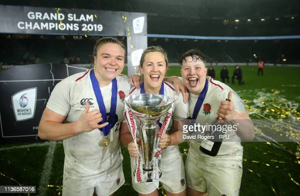 Sarah Bern Marlie Packer and Hannah Botterman of England celebrate after England win the Grand Slam during the Guinness Women's Six Nations match...