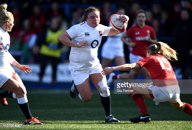 Sarah Bern of England breaks through to score a try during the Wales Women and England Women match in the Women's Six Nations at Cardiff Arms Park on...