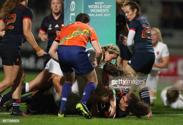 Sarah Bern of England crashes over the line to score the opening try during the Women's Rugby World Cup 2017 Semi Final match between England and...