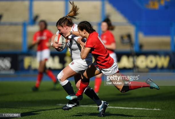 Sarah Bern of England runs past Jasmine Joyce of Wales before touching down for the fourth try during the Wales Women and England Women match in the...