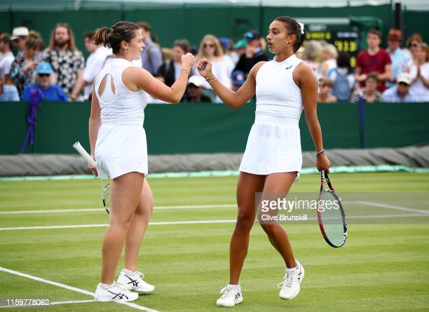 Sarah Beth Grey of Great Britain and Eden Silva of Great Britain celebrate in their Ladies' Doubles first round match against Sorana Cirstea of...