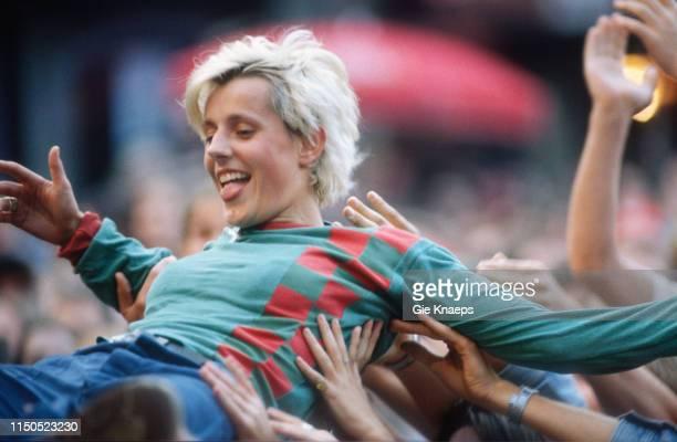 Sarah Bettens of K's Choice crowdsurfing at Marktrock Festival, Leuven, Belgium, 15th August 1996.