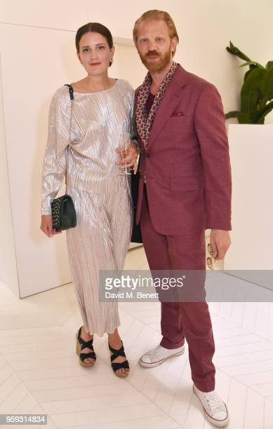 Sarah Bjrlin and Alistair Guy attend an exclusive summer cocktail party showcasing the Linda Farrow x Lelloue collection on May 16 2018 in Cannes...