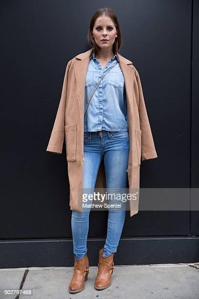 Sarah Blank is seen on Michigan Avenue wearing a camel Forever 21 coat light blue denim HM shirt blue denim HM jeans light brown leather Francesca's...
