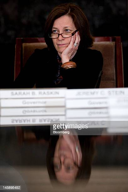 Sarah Bloom Raskin governor of the of the US Federal Reserve listens during an open meeting of the Federal Reserve Board in Washington DC US on...