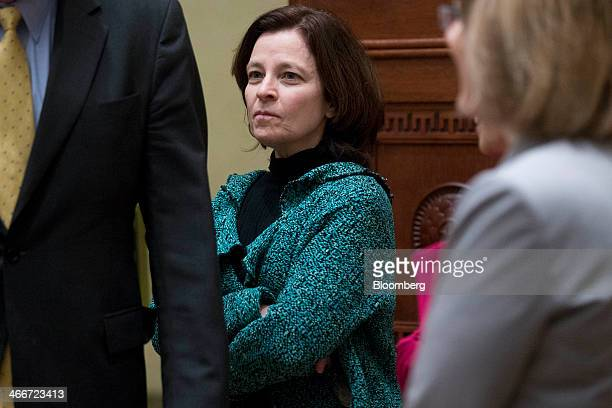 Sarah Bloom Raskin governor of the US Federal Reserve waits to watch Janet Yellen chairman of the US Federal Reserve take the oath of office as chair...