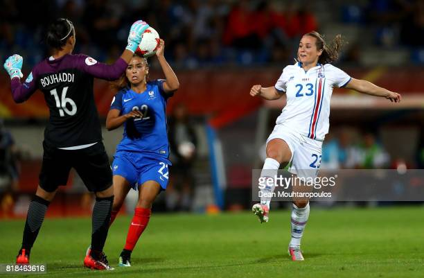 Sarah Bouhaddi goalkeeper of France makes a save on Fanndís Fridriksdóttir of Iceland during the Group C match between France and Iceland during the...
