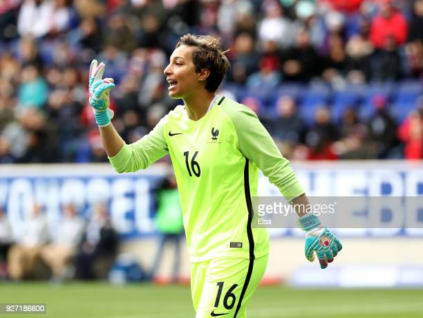 Sarah Bouhaddi of France directs her teammates in the first half against the United States of America during the SheBelieves Cup at Red Bull Arena on...