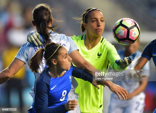 Sarah Bouhaddi of France grabs the ball while holding onto Rachel Williams of England and Jessica Houara defending during the SheBelieves Cup at...