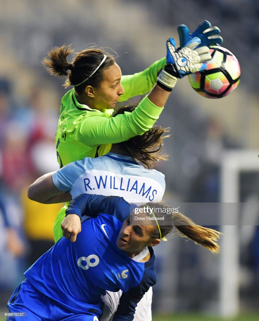 Sarah Bouhaddi #16 of France makes a save over Rachel Williams #23 of England and teammate Jessica Houara #8 during the SheBelieves Cup at Talen Energy Stadium on March 1, 2017 in Chester, Pennsylvania. France won 2-1.