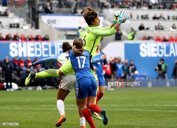 Sarah Bouhaddi of France makes the stop as teammate Marion Torrent defends during the SheBelieves Cup at Red Bull Arena on March 4 2018 in Harrison...